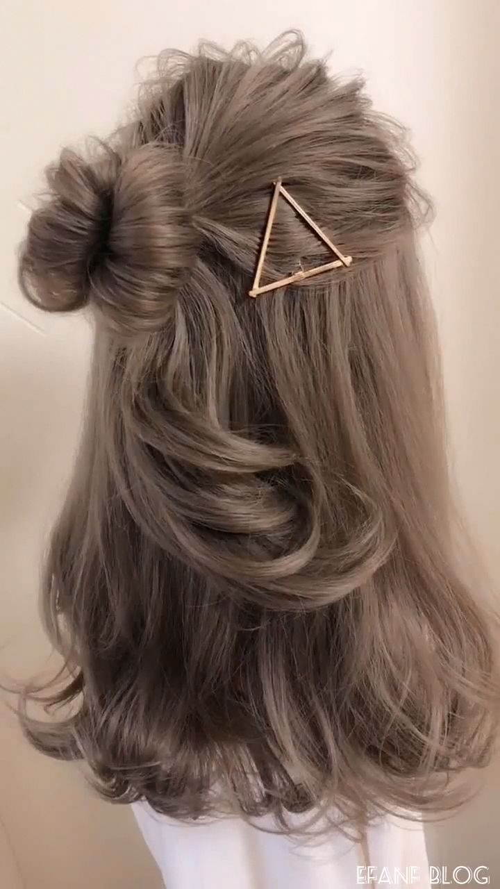 This style, with its loose bun and textured braid, is incredibly versatile. It's sophisticated enough to wear in an offce setting, yet playful enough for a trip to the nearest sweet shop. No matter what you do, you'll be looking your best! #Braidedforshorthair