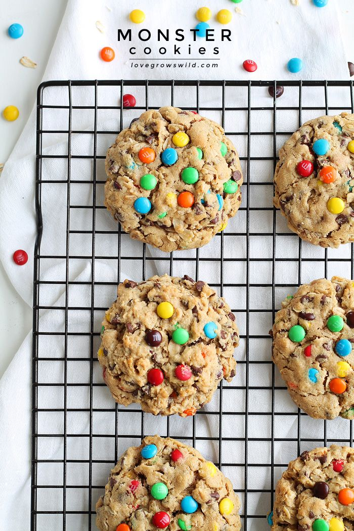 Monster Cookies - Big, chewy peanut butter cookies loaded with sweet chocolate chips, M&M candies, and oats! Get the recipe at LoveGrowsWild.com