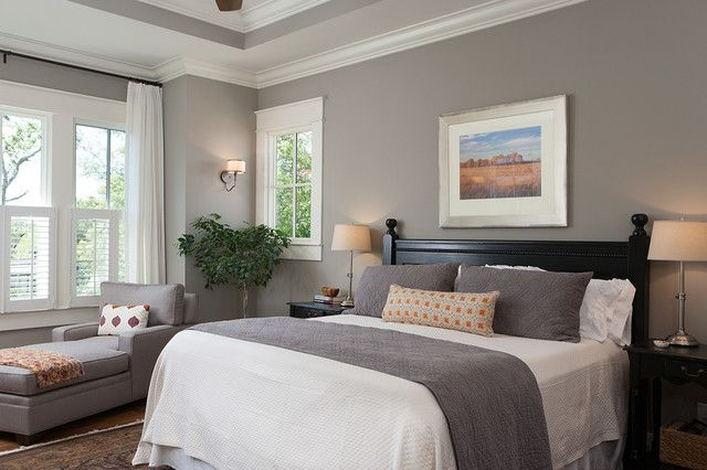 "There's nothing gloomy about this gray bedroom. The walls are painted a medium warm gray that adds just the right amount of contrast against the beautiful white trim. It's a neutral palette, but because the colors are neither overly warm nor too cool, it's a fresh, soothing space. Benjamin Moore ""White Dove"" for trim and HC-105 Rockport Gray for walls."
