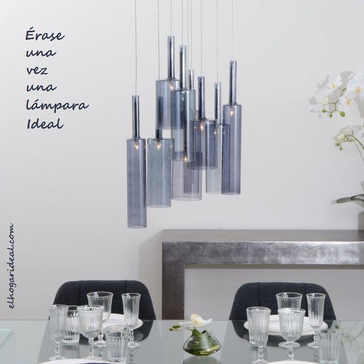 Lámpara de techo de acero inoxidable y cristal con 9 pantallas de cristal en forma de botella azul. http://elhogarideal.com/es/10-iluminacion
