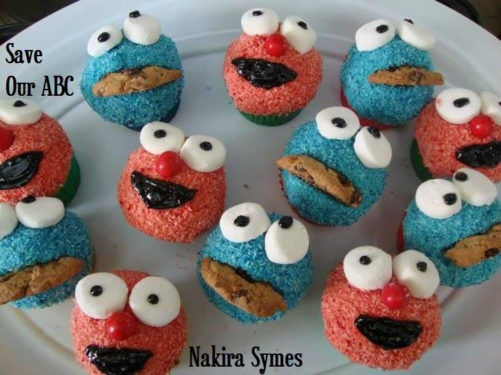 """Cookie Monster and Elmo Cupcakes by Home Baker Nakira. In Australia we are losing funding to our independent television channel The ABC. I am starting a collection of photos from our local Cake Decor in Cairns home baking mums and dads to support the facebook page (not run by me) """"Australians Baking Cakes for the ABC."""