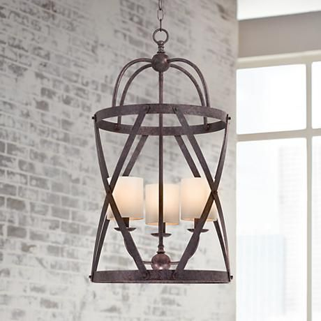 A romantically curved bronze finish cage adds intrigue to this transitional hourglass metal pendant light.