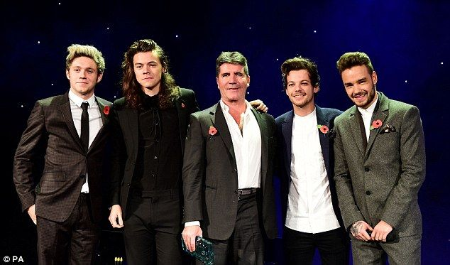 Simon Cowell Accepts The Music Industry Trust Award From One Direction