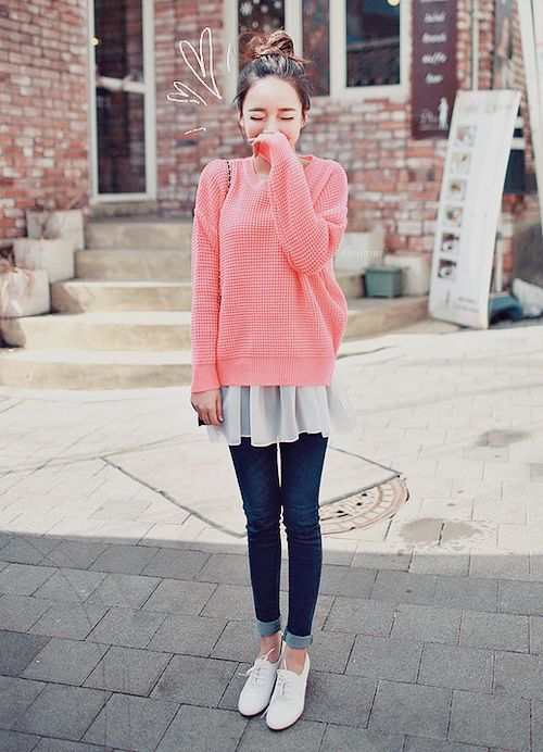 Pink sweater with a white blouse skinny jeans and white shoes
