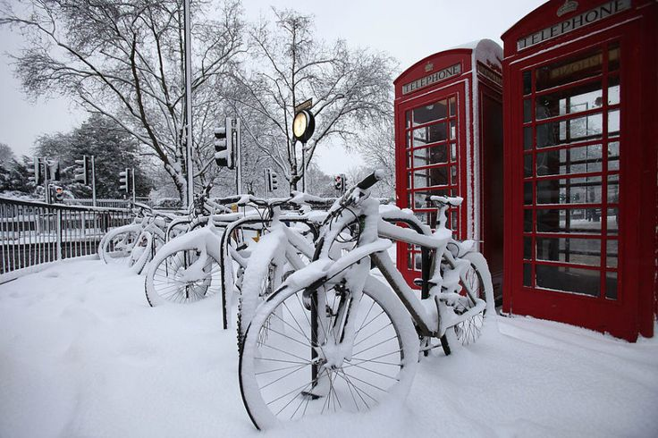 Bikes are covered in snow outide Queensway Tube Station in London, England. Photo: Getty)