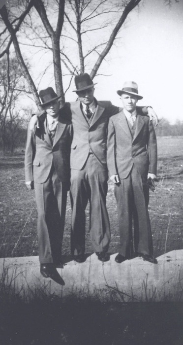 these are members of the barrow gang: clyde barrow, henry methvin and raymond hamilton.  methvin's father made an agreement with the FBI, that if the charges against his son were dropped, he would then betray bonnie and clyde.  so he did. he pretended his truck had a flat tire in the middle of the road that led to the couple's hideout. when clyde stopped to help, they didn't realize a posse was hiding in the bushes. they riddled the car with bullets and that was the end for bonnie and clyde.