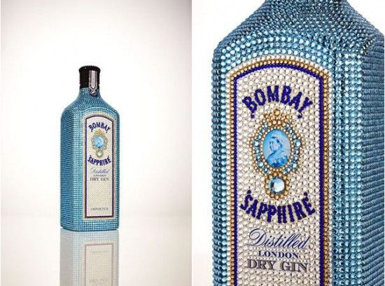The crystal studded bottle is a true keepsake with the stones on each bottle being laid by hand to ensure they came into contact with the crystals around them, and that no space on the bottle surface was left undecorated. The bottles have been designed by Yves Behar using 15,000 Austrian Swarovski crystals.Gin Bottle, Sapphire Bottle, Sapphire Gin, Bombay Sapphire, Bedazzled Liquor Bottle, Swarovski Crystals, Swarovski Bottle, Sapphire Swarovski, Swarovski Studs