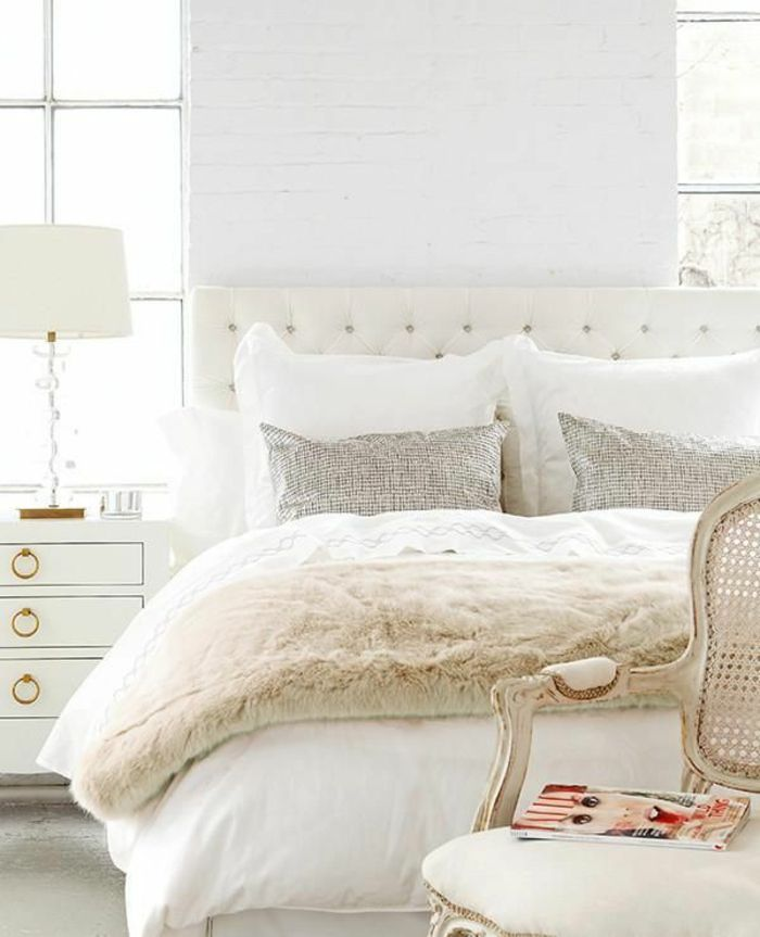 Transitional #bedroom with upholstered #headboard and #antique chair