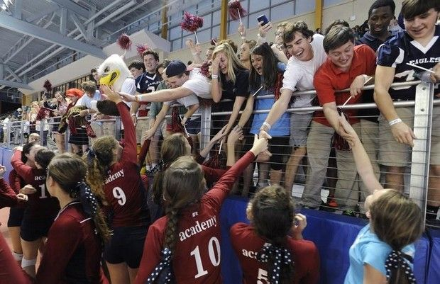 Montgomery Academy congratulate players after they won the AHSAA Class 2A Volleyball Championship at the Crossplex in Birmingham, Ala. on Thursday October 31, 2013.(Mickey Welsh, Montgomery Advertiser)