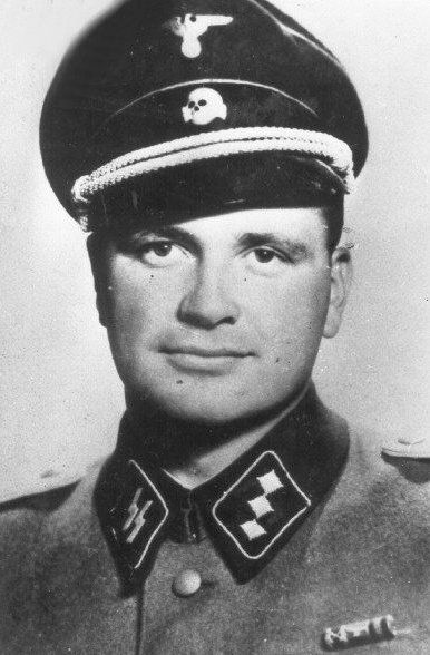 "Kurt Franz was a commanding officer at the Belzec and Treblinka death camps. One of the cruelest and most barbaric SS camp butchers, Franz would set his St Bernard dog on prisoners ""for fun"". At Treblinka, he was in charge of the transfer of prisoners directly to the gas chambers. His baby face belied his cruelty and vicious, sadistic nature. After the war he succeeded in evading capture until 1959. During trial in 1965 he denied all charges. He spent 28 years in prison and died in 1998."