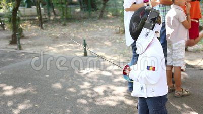 Children on fencing training - child dressed as a fencing.