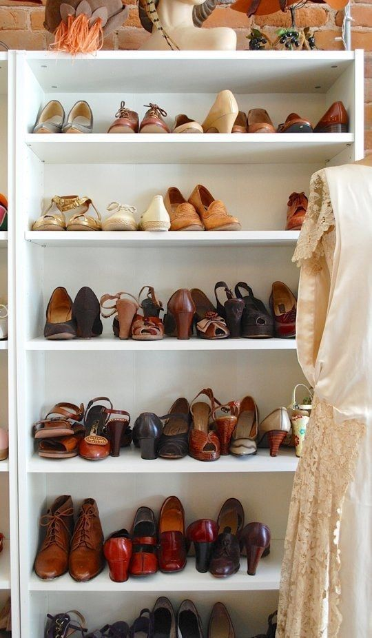 A bookcase disguised as custom built-in shoe shelves.