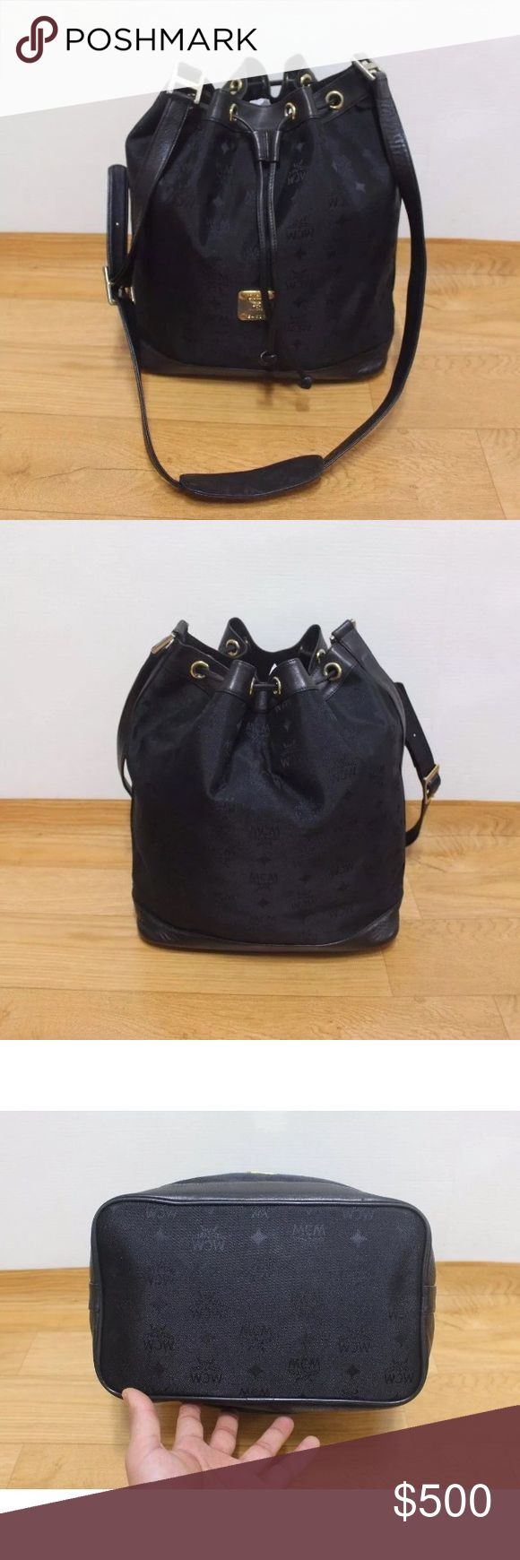 Black MCM bucket Bag Awesome vintage mcm bag in great condition! No tears or holes , scratches and fading on metal pieces but still in good condition Great size purse! Price is through 🅿️🅿️ includes shipping MCM Bags Crossbody Bags