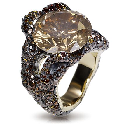 Fabergé TREE ROOT RING. This piece is set in 18k yellow gold and silver and features 660 yellow, orange and brown diamonds. The centre stone is a natural round diamond (fancy brownish orange) of 13.20 carats.