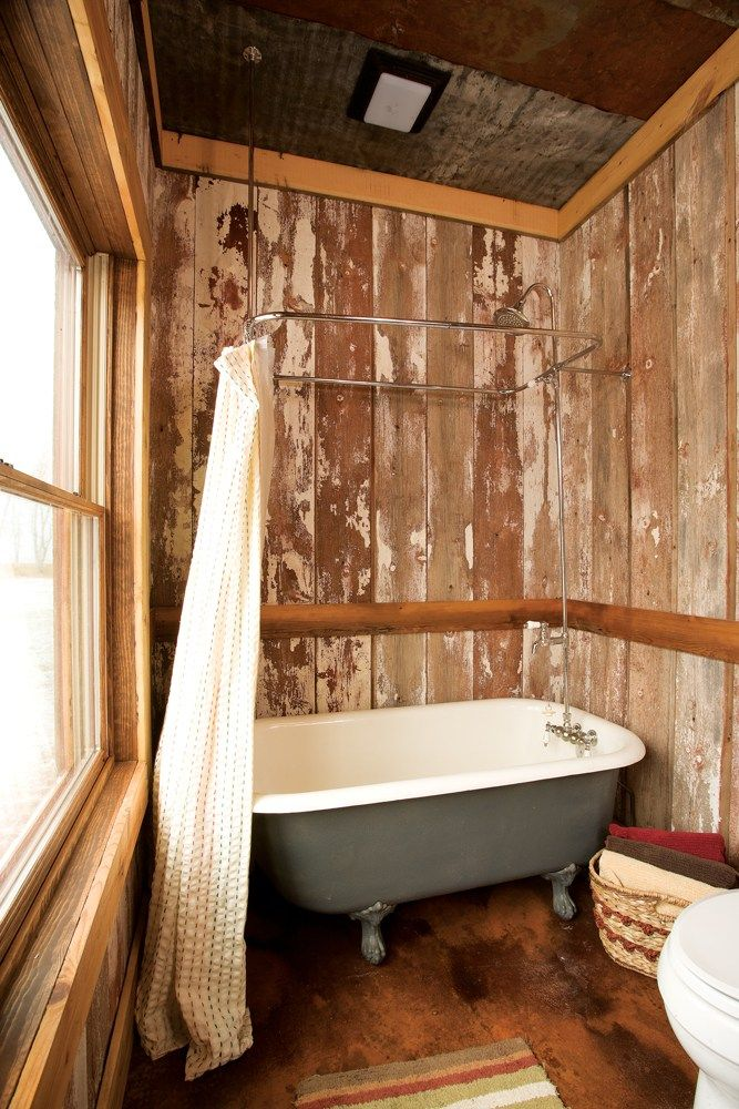Aged Timbers Make A Fitting Backdrop For The Vintage Clawfoot Tub In The Lower Level