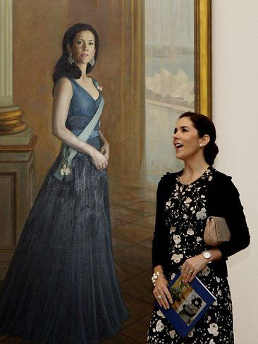 Princess Mary and Crown Prince Frederik view a portrait of Her Royal Highness by Sydney-based artist Jiawei Shen during a visit to the National Portrait Gallery in Canberra today. Picture: Ray Strange