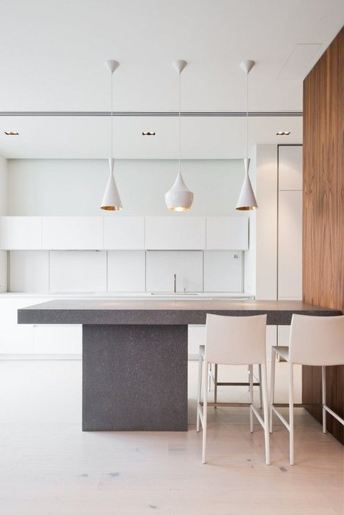 these white Tom Dixon beat lamps are stunning and would look great over the peninsula in the kitchen