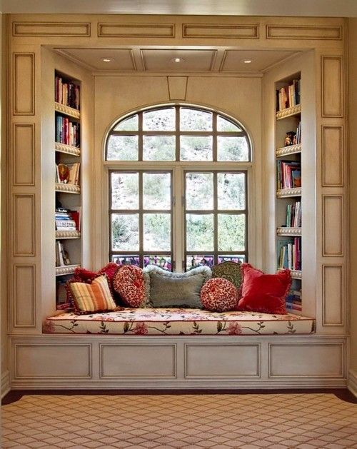 window seat with book shelves  for long winter days of watching it snow, sipping on hot chocolate, snuggled in my quilt and reading a glorious book!...A must. Have. Do this in an addition someday?!