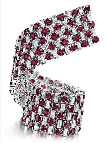 RUBY AND DIAMOND BRACELET - oval-cut rubies, spaced by baguette-cut diamonds, mounted in platinum