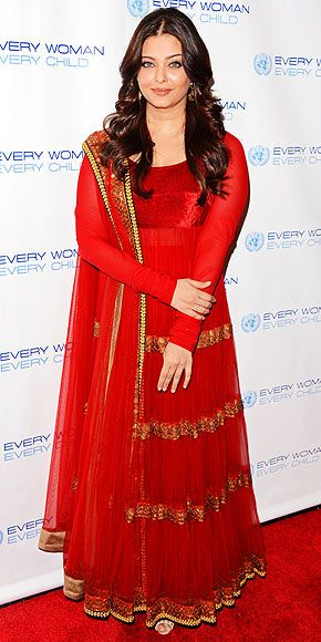 AISHWARYA RAI  Red and black appear to be the hottest colors of the evening. In this case, the Indian star attends the Every Woman Every Child dinner in N.Y.C. wearing a vivid crimson sari with gold embroidery, plus long loose waves.