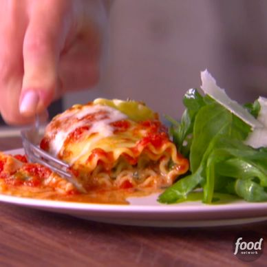 Put a fun twist on classic Lasagna with Giada's Lasagna Rolls. The noodles are filled with a creamy spinach ricotta and prosciutto mixture, topped with marinara and mozzarella and baked until the cheese is golden.