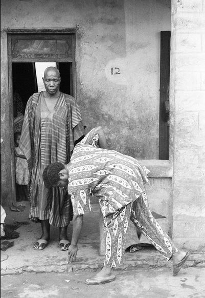 """""""ekule baba""""  Greetings in Yoruba culture, 1960 Vintage Nigeria  Know as """"Idobale"""" in the Yoruba language and Postrate in english or at least that's what was yelled at me when I was younger and did not greet an older person fast enough. The version pictured above is the modified version. Originally you would have had to go all the way down like you were about to do a push up."""