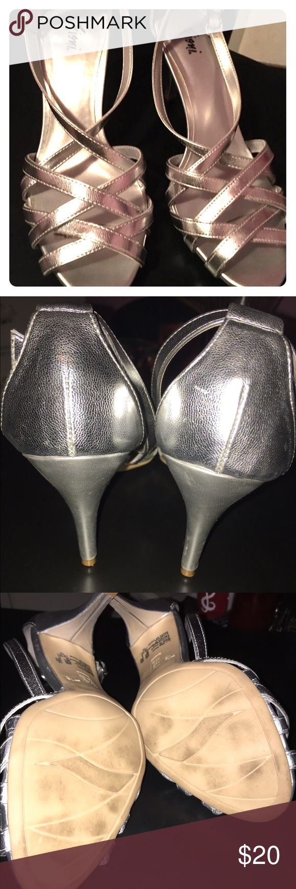Silver strappy sandals Beautiful silver heels. Great for dressing up jeans or a formal attire Shoes Heels