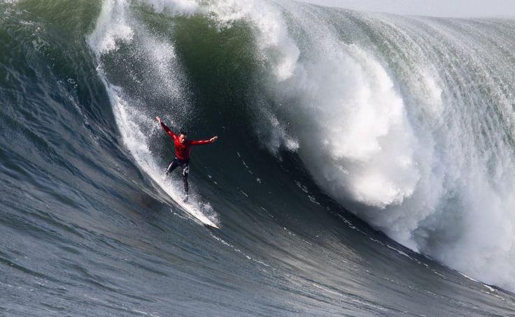 Big wave surfing at Mavericks, California.