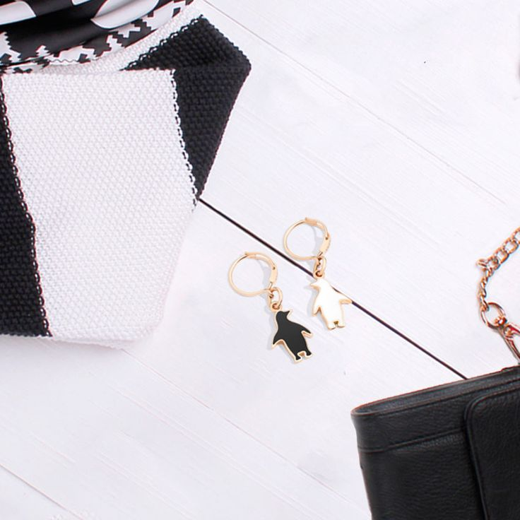 Dodo black and white penguin earrings for a stunning black and white outfit.