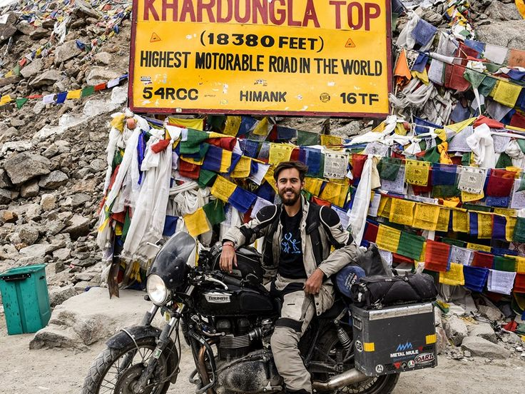 Brit becomes youngest person to circumnavigate the world by motorcycle