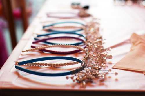 Make inexpensive homemade tiaras by twisting wired wedding beads (craft stores) onto headbands from Target.