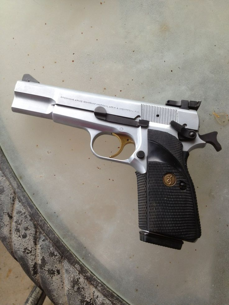 Browning Hi Power - hard-chromed with a Millet rear sight.