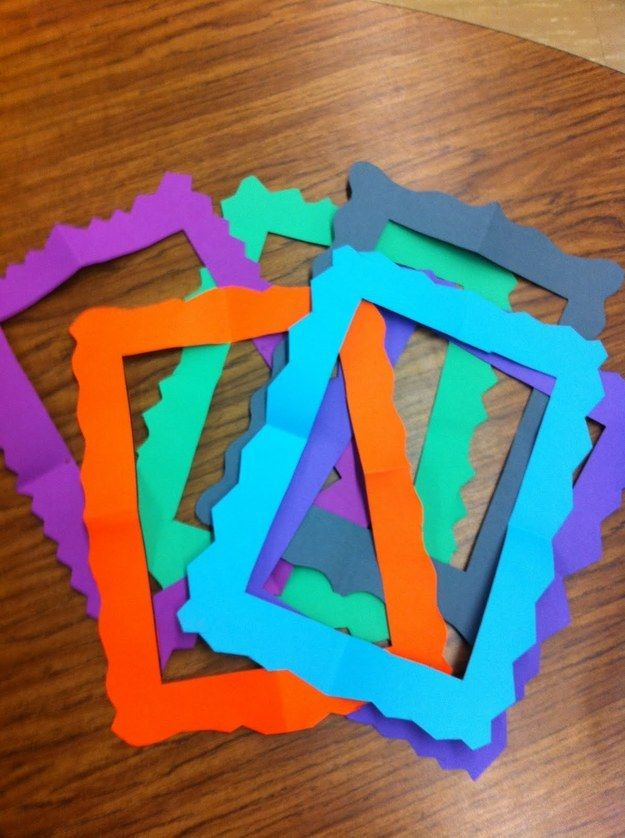 Kids can make super easy picture frames out of construction paper.  Fold the paper into fourths, cut out an L shape, and then cut a jagged or scalloped design along the outer edge.