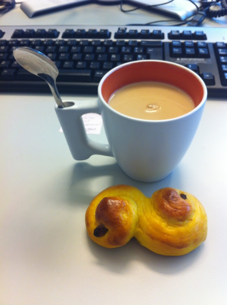 Lussekatter (Swedish Advent saffron bun) and English breakfast tea with a dollop of milk.  December'12. Photo ©Blanca Oliver