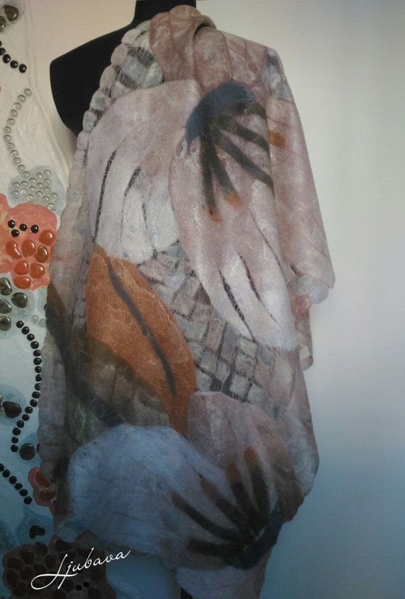 Back to listings Woman Scarf Nuno Felt Scarf shawl Felted Scar Large shawl wrap Nuno Felted Handmade Unique handmade scarves.  Unique felted shawl, like a garden of magnolias. Manufactured in technique mosaic of merino wool and fine silk. Scarf graceful, wonderful soft, air and delicate, yet durable and practical you can it as an evening accessory and every day.  One of a kind!  Dimension: 205*65 Material: merino wool, fine silk  Care: Hand wash in warm water, do not wring, roll in a towel…