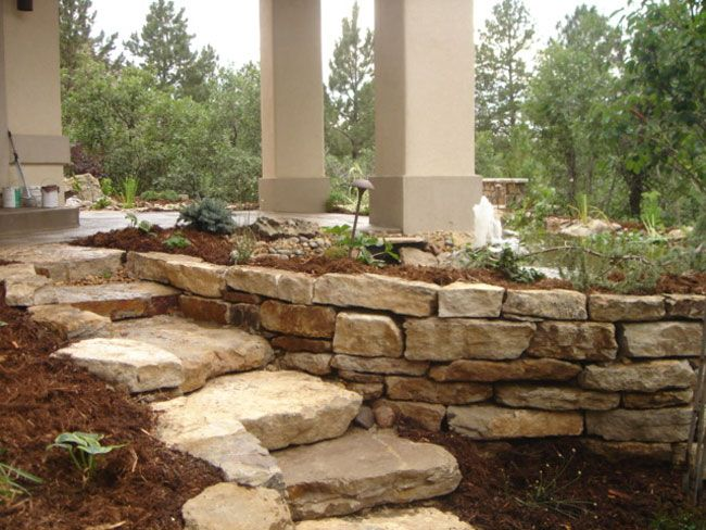 Retaining wall flower box ideas pinterest the for Stone retaining wall ideas