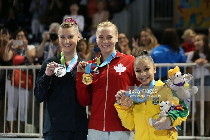 July 13 - Gymnastics Artistic - Women's All Around.  Silver medallist Madison Desch of USA , gold medallist Ellie Black of Canada, bronze medallist Flavia Lopes Saraiva of Brazil pose at the podium after winning in Gymnastics Artistic during Toronto 2015 Pan Am Games at Toronto Coliseum on July 13, 2015 in Toronto, Canada.