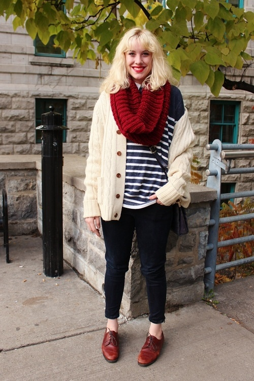 Blonde hair, red lips, circle scarf, striped sweater, navy denim, cable knit, Oxford shoes.     STYLE ADVICE OF THE WEEK: Traditional With A Twist