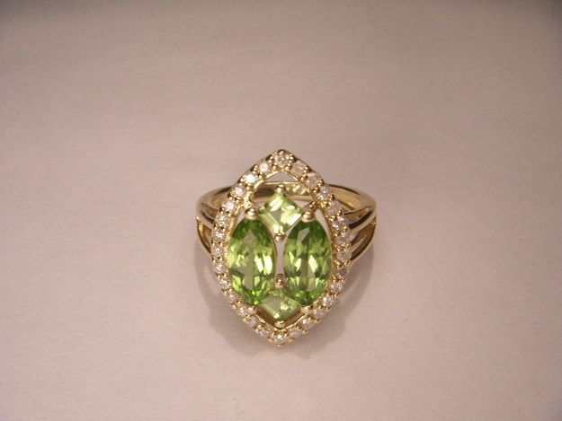 Vintage Peridot, Diamond, and Yellow Gold Ring, $795 | 45 Engagement Rings Inspired By Disney Princesses