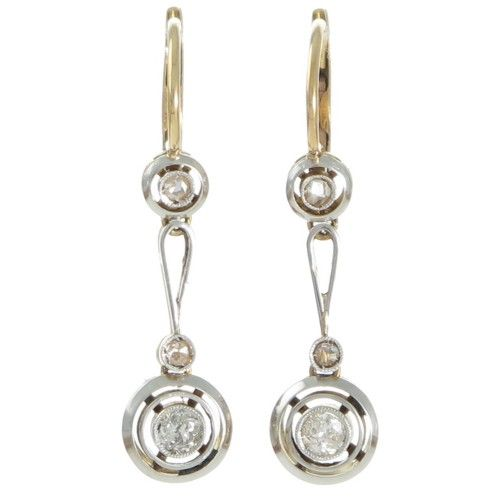 A pair of platinum topped 18ct yellow gold Edwardian earrings each with a bezel set diamond of estimated weight 0.05ct set within a spaced double row polished frame articulated beneath a diamond at the base of a long tapering double bar with a diamond set to the top within a spaced single frame at the front of the European style hook fittings. www.rutherford.com.au