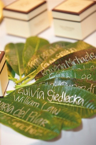 Leaves used as escort cards for a themed destination wedding