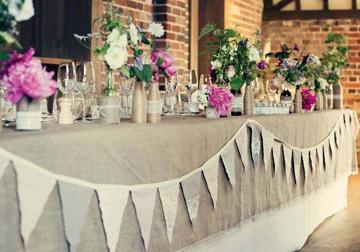 Wedding table decorations. I Love this Hessian table runner and bunting