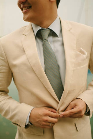 The groom wore a beige suit and a sea green necktie to match a nautical-themed wedding in Batangas. | www.BridalBook.ph