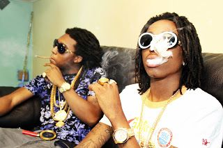 """Quavo, a third of the rap triumvirate Migos, has called Lil B out on Twitter. The threatening Tweet was uploaded around 9:30 this morning. The straightforward """"I'LL BEAT YO ASS BOI"""" didn't go unnoticed, and Lil B has been firing off on Twitter all day regarding his surprise at Quavo's attack.  Coincidentally, Lil B has just overcome a beef with L.A. rapper The Game. Just this week, Lil Durk and The Game resolved a similar beef; it seems that The Game either has a chip on his shoulder or is…"""