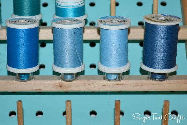 Sugar Tarts Crafts -- thanks for this genius idea of storing bobbins on the thread rack under matching spools... and we love the tip on keeping the tails neat, too!