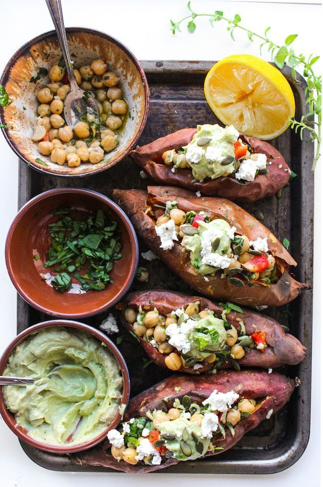 Mediterranean stuffed sweet potatoes with marinated chickpeas and topped with an avocado tahini sauce, (grain free & vegan).