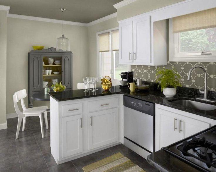 cuisine blanche et noire avec peinture murale vert olive
