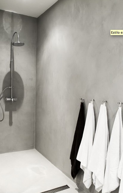 concrete shower2. MINIMAL OPEN PLAN SHOWER. SIMPLE ROBE HOOKS IN ROW. POLISHED CONCRETE/PLASTER WALLS