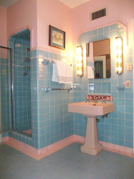 pink and aqua bathroom.  This is just really cute for some reason...