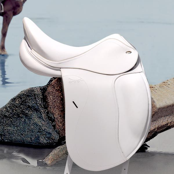 White Tekna Dressage saddle. Ohhh.. can't keep my black dressage saddle clean....can't imagine how this one would look after 4 rides a day...
